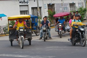 Three wheeled motorcars dominate the streets of Iquitos, Peru.