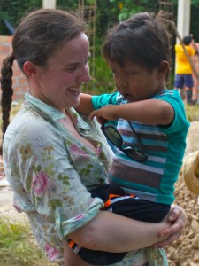 Kate and one of the village children.